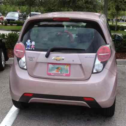 The rear view of a pink Chevrolet Spark