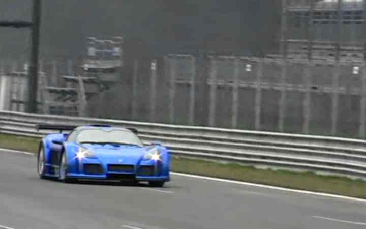 A picture of a Gumpert Apollo at a race track